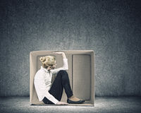 Girl in box Royalty Free Stock Photography