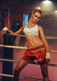 Girl boxer in boxing ring Stock Images