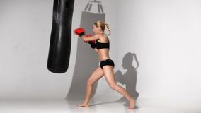 Girl boxer finished the training with a punching bag stock video footage