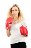 Girl boxer in red gloves Stock Photos
