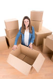 Girl with boxes Royalty Free Stock Photography