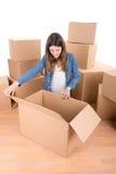Girl with boxes Stock Photos