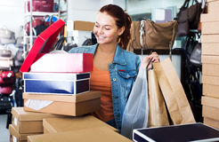 Girl and boxes with new pairs of shoes Stock Photos