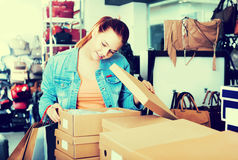 Girl and boxes with new pairs of shoes Royalty Free Stock Photo