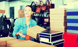 Girl and boxes with new pairs of shoes Royalty Free Stock Photography