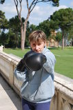 Girl boxing. With black gloves Royalty Free Stock Images