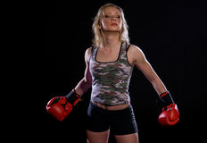Girl with boxing gloves. Blonde girl wearing boxing gloves Stock Image
