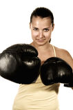 Girl in boxing gloves. Toned girl in black boxing gloves Stock Photo