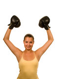 Girl in boxing gloves. Girl in black boxing gloves celebrating victory Royalty Free Stock Photos