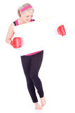 Girl in boxing gloves with blank sign Stock Image
