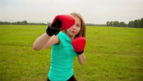 The Girl in Boxing Gloves in a Meadow stock video