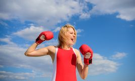 Girl boxing gloves symbol struggle for female rights and liberties. Fight for female rights. Girls power concept. Woman. Strong boxing gloves raise hands blue royalty free stock image