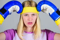 Girl boxing gloves tired to fight. Strong woman suffer pain. Girl painful face embrace head with boxing gloves. Headache. Remedies. Headache concept. Keep calm stock photo