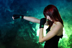 The girl in boxing pose Stock Images