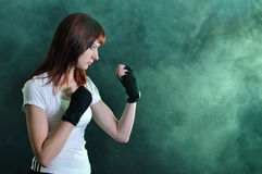 The girl in boxing pose Stock Photos