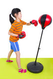 Girl boxing on a punching bag Stock Photos