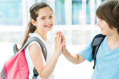 Girl and boy with backpacks. Outdoors Royalty Free Stock Image