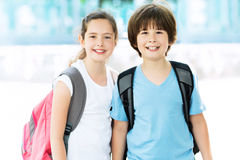 Girl and boy with backpacks Royalty Free Stock Images