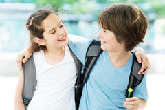 Girl and boy with backpacks Stock Photo