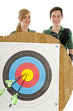 Girl and boy behind bulls eye Stock Photos