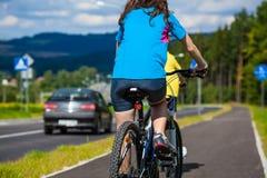 Girl and boy biking Royalty Free Stock Photos