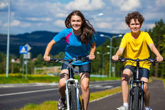 Girl and boy biking Royalty Free Stock Photos