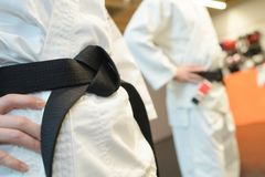 Girl and boy with black belt in martial arts Royalty Free Stock Photos