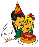 Girl and boy blow out the cake Stock Images