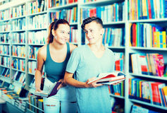 Girl and boy in book store Royalty Free Stock Photo