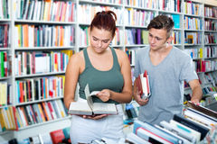 Girl and boy in book store Stock Photos