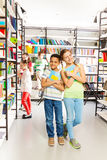 Girl and boy with books stand close in library Royalty Free Stock Photography