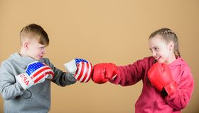 Girl and boy boxing competitors. Battle for attention. Child sporty athlete practicing boxing skills. Boxing sport royalty free stock photo