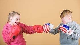Girl and boy boxing competitors. Battle for attention. Child sporty athlete practicing boxing skills. Boxing sport stock photo