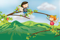 A girl and a boy at a branch of a tree Royalty Free Stock Images