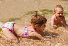 Girl, boy, brother, sister, sea, vacation, summer, ocean, sand, travel Royalty Free Stock Image