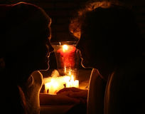 Girl and boy in candleligt stock images