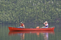 Girl and boy canoeing. Clearwater Lake, Wells Gray Provincial Park, British Columbia, Canada Royalty Free Stock Images