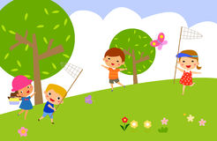 Girl and boy catch butterflies on a green lawn Royalty Free Stock Photos