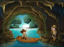 A girl and a boy at the cave Stock Images