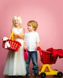 Girl and boy children shopping. Couple kids hold plastic shopping basket toy. Kids store. Mall shopping. Buy products. Play shop game. Cute buyer customer stock images