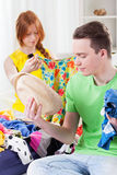 Girl and boy choosing clothes Stock Photography