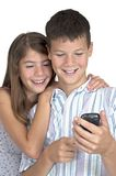 Girl & boy close looking mobile phone Royalty Free Stock Photography