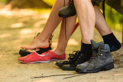 Girl and boy compare footwear. Stock Images