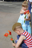 Girl and boy  congratulates veterans on Victory Day and wants to Stock Photo