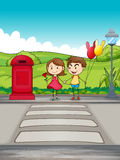 A girl and a boy crossing the street Royalty Free Stock Images