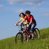 Girl and boy cycling Stock Photography