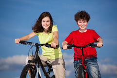 Girl and boy cycling Stock Photo