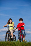 Girl and boy cycling Stock Image