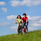 Girl and boy cycling Stock Photos