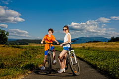 Girl and boy cycling Royalty Free Stock Image